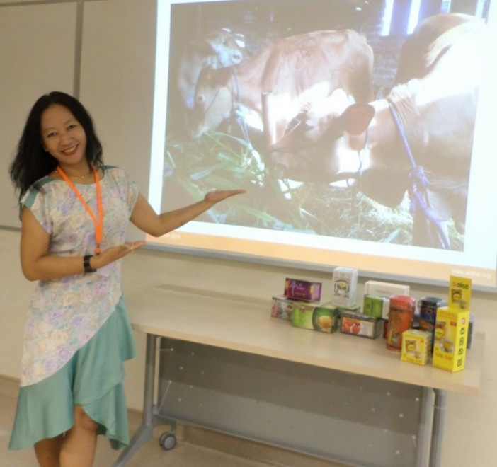 Emi Lestari in her own dress design and her cow business