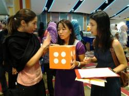 Maria talking to potential Aidha students during Foreign Domestic Workers Day.