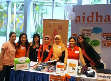 Maria (far left) working with the trainees during the Foreign Domestic Workers Day event.