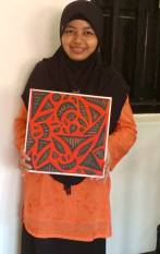 Tri's artwork now occupies a place of pride in the Aidha office.