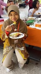 Tri in her traditional kebaya during Kartini Day at Aidha, which she helped organise.